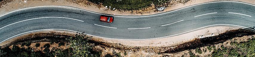 Red car on a curvy road