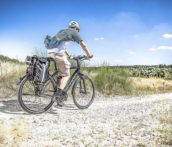 Bicyclist riding on bike trail